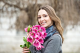 Woman with tulips. Beautiful woman with flowers.