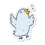 distressed sticker of a cartoon bird singing