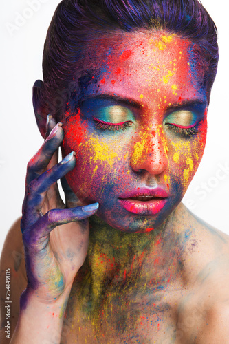 Beautiful woman with bright creative art makeup