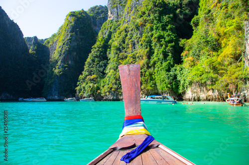 Fototapeten Strand Traditional long-tailed boat Thailand, tropical beach on a background of rocks