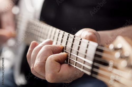 man playing guitar - 254174408