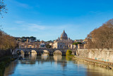 Rome skyline with Vatican St Peter Basilica and St Angelo Bridge crossing Tiber River in the city center of Rome Italy. It is historic landmark of the Ancient Rome and travel destination.