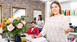 Leinwanddruck Bild - Portrait of young woman  administrator inviting to beauty salon
