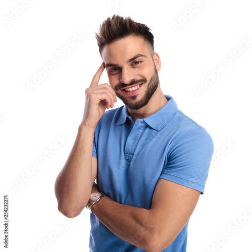 Leinwanddruck Bild Portrait of a good-looking, well-dressed man wearing a blue polo