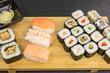 variations of sushi rolls with maki, nigiri and california rolls