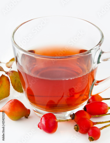 Rose hip tea and glass cup with fruits - 254252215