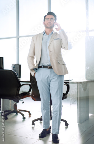 serious businessman talking on mobile phone
