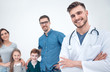 Leinwanddruck Bild - smiling family doctor and his patients