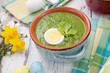 Leinwandbild Motiv Green Gazpacho Soup With Eggs