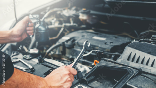 mata magnetyczna Auto mechanic working in garage Technician Hands of car mechanic working in auto repair Service and Maintenance car check.
