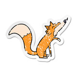 distressed sticker of a cartoon fox