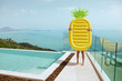 Summer vacation. Woman with pineapple float having fun near pool
