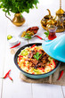 Leinwanddruck Bild - Tajin with couscous, vegetables and meat on white background