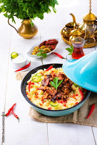 Tajin with couscous, vegetables and meat on white background - 254324653