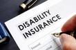 Leinwanddruck Bild - Man is filling in Disability insurance form.