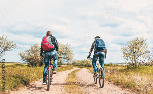 Two cyclists on the road - 254379442