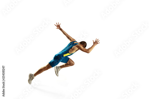 Leinwandbild Motiv Young caucasian man running isolated on white studio background. One male runner or jogger. Silhouette of jogging athlete with shadows.