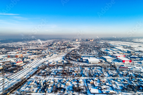 Aerial view of the modern city district. Winter, sunny day