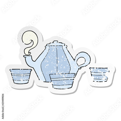 distressed sticker of a cartoon teapot and cups © lineartestpilot