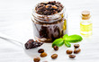 Spa concept with natural coffee scrub and oil on white background