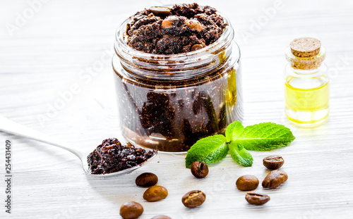 mata magnetyczna Spa concept with natural coffee scrub and oil on white background