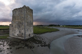 Stormy skies over Carrigafoyle castle in the west of Ireland