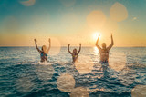 Happy family playing in the sea