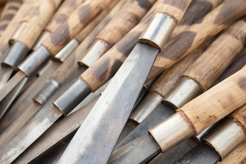 A lot of knives, bamboo handle. © Sachchakorn
