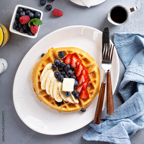 Waffle with fresh banana and berries for breakfast