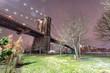 The Brooklyn Bridge at night. Winter landscape from Brooklyn Bridge Park, New York City