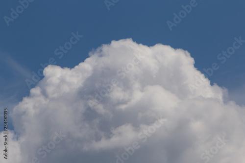 top of cumulus cloud against blue sky - 254461095
