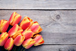 Bouquet of tulips on grey wooden table