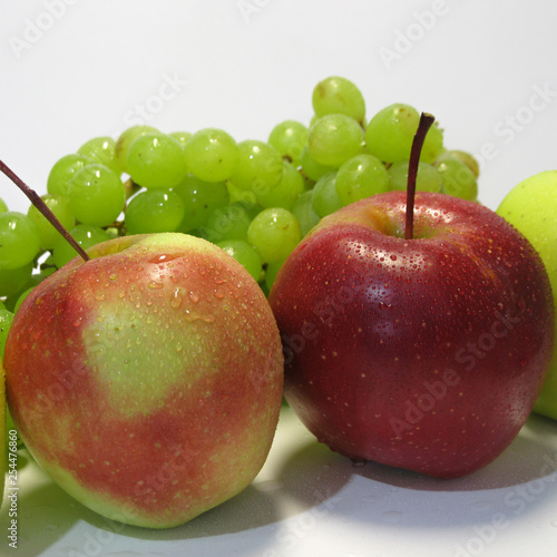 Apples and grapes - beauty and benefit, taste and health, an inexhaustible source of vitamins. © Andrey