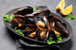 Leinwanddruck Bild - Delicious mussels with tomato sauce and parsley