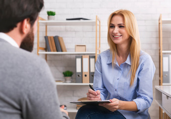 Psychologist having session with patient in office