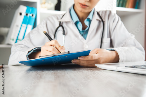 doctor woman hand document with pen