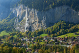 View of Staubbach waterfall and Lauterbrunnen village in the valley in Switzerland.