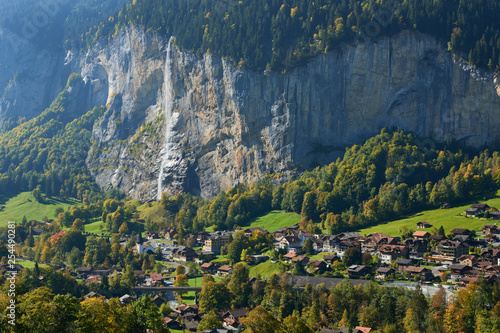 View of Staubbach waterfall and Lauterbrunnen village in the valley in Switzerland. © thecolorpixels
