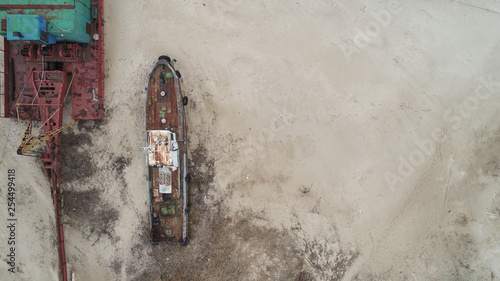 old broken boat stand on sand with lot of old dust motel aired shoot  - 254499418