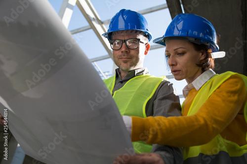 Close up of architect watching blueprint