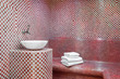 Leinwanddruck Bild - Traditional Turkish hamam with stone walls, sink and stack of  towels