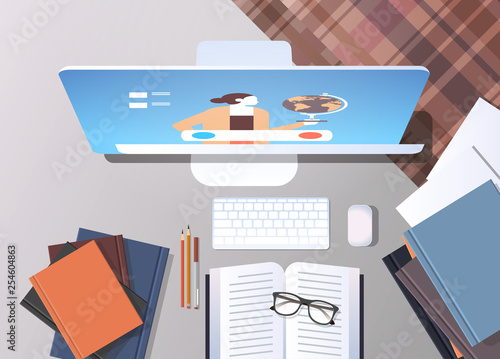 university student workplace elearning online education concept top angle view desktop with books and computer monitor office stuff
