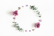 Leinwanddruck Bild - Flowers composition. Wreath made of eucalyptus branches and rose flowers on white background. Flat lay, top view, copy space