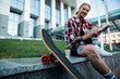 Selective focus of a skateboard with a cheerful man in the background