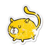 distressed sticker of a cartoon happy cat