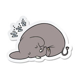 sticker of a cartoon sleeping elephant