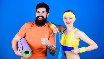 Athletic Success. Sporty couple training with fitness mat and jump rope. Happy woman and bearded man workout in gym. Sport equipment. Strong muscles and body. Practice with purpose, play with passion © Roman Stetsyk