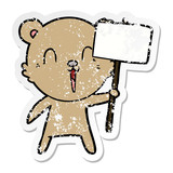 distressed sticker of a happy cartoon bear with placard