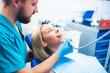 Dentist treating blond smiling girl