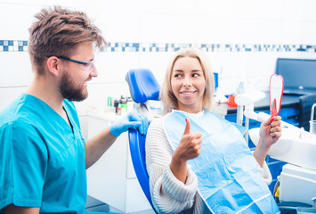 Satisfied patient with dentist's work